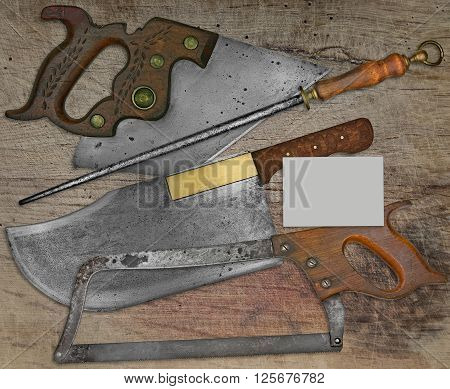vintage butcher shop tools over stained wooden tablespace on business card for your text