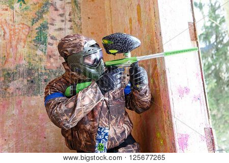 Saint-Petersburg, Russia - April 10, 2016: Paintball student tournament of Bonch Bruevich university in Snaker club. Shooter.
