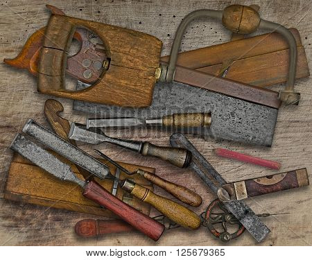 vintage woodworking tools over stained wooden bench