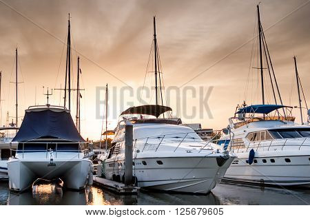 Yacht and boats at the marina in the evening Phuket Thailand