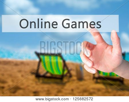Online Games - Hand Pressing A Button On Blurred Background Concept On Visual Screen.
