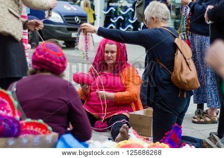 BATH SOMERSET UK - APRIL 14 2016  Yarn bombing. An organised group cover poles and posts with knitting using wool to brighten up Milsom Street in the city centre
