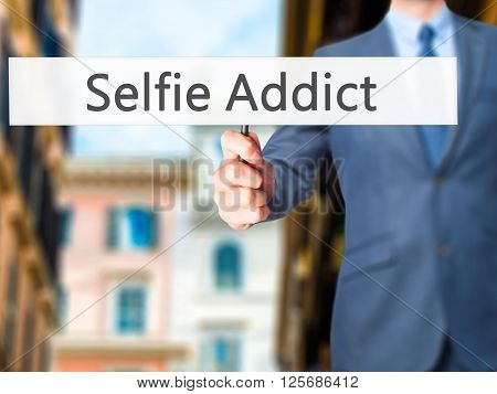 Selfie Addict - Businessman Hand Holding Sign