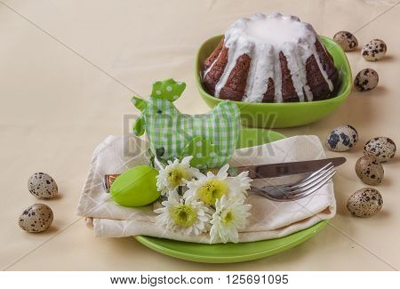 Festive Easter table setting with textile chicken flowers and easter eggs. (Mass-produced products)
