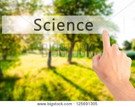 Science - Hand Pressing A Button On Blurred Background Concept On Visual Screen.