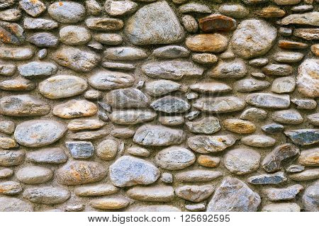 Old stone wall background texture close up