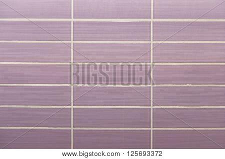 Geometric violet tile background texture close up