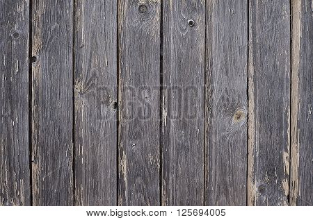 Old dark wooden fence background texture close up