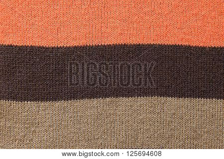 Striped woolen scarf background texture close up