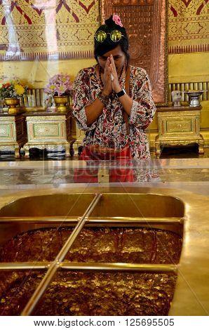 Thai People Pray With Buddha's Footprint