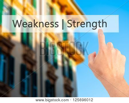 Weakness  Strength - Hand Pressing A Button On Blurred Background Concept On Visual Screen.