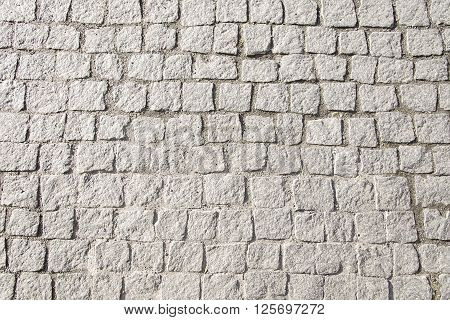 Grey stone pavement background texture close up