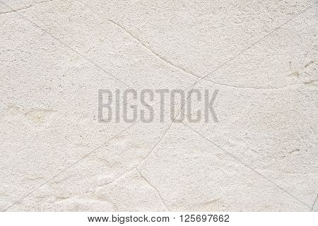 Old white stone wall background texture close up