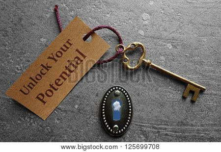 Unlock Your Potential message with gold key