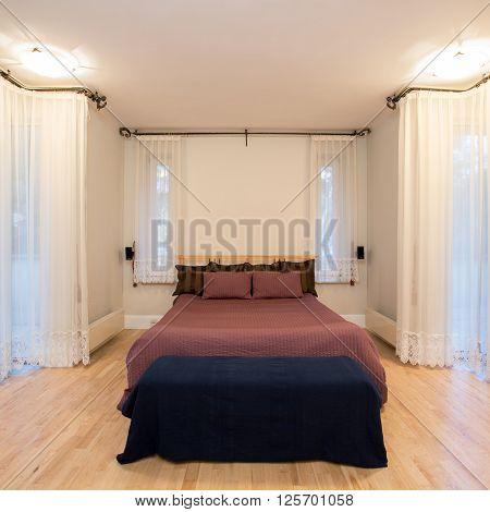 Huge Window In Cozy Bedroom