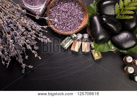 Spa Concept With Stones, Flowers , Essential Oils And Mineral Salt  On Wooden Table