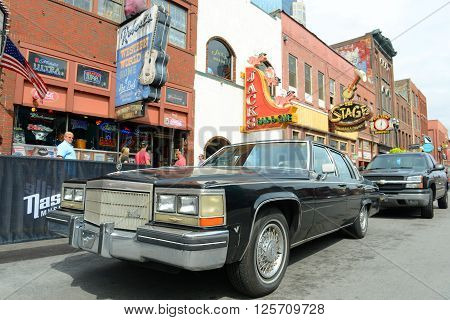 NASHVILLE,TN,USA - SEP 27: 1978 Cadillac Deville at historical Broadway on Sep. 27, 2015 in downtown Nashville, Tennessee, USA. Lower Broadway is famous for entertainment district of country music.