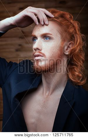 Portrait of a Man with red hair he is metrosexual.