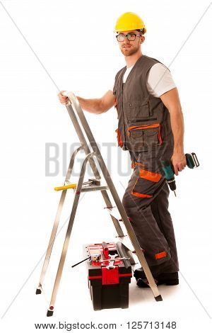 Young man worker clombing on metal ladder isolated over white background