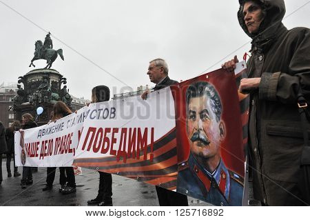 ST. PETERSBURG RUSSIA - MAY 1: During the celebration of May Day. Communist party supporters take part in a rally in May 1 2010. Portrait of Soviet dictator Josef Stalin