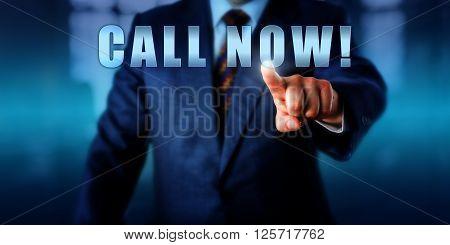 Torso of businessman is pushing CALL NOW! on a virtual touch screen interface. Business concept and call to action for telemarketing mail order direct marketing and email marketing campaigns.
