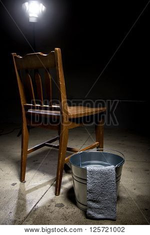 Torture chamber with a water bucket for controversial waterboarding