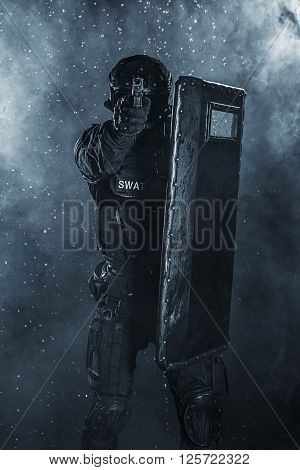 Spec ops police officer SWAT with ballistic shield