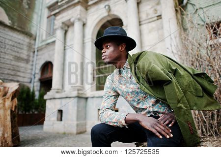 Fashion Portrait Of Black African American Man On Green Velvet Jacket At His Shoulders And Black Hat