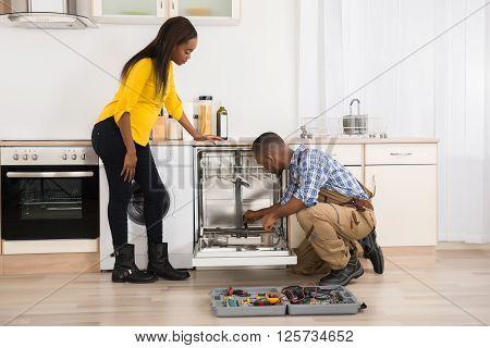Repairing Dishwasher In Kitchen