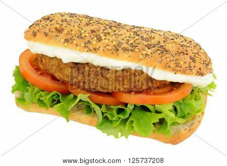 Southern fried chicken burger in a seed topped bread roll with lettuce and tomato isolated on a white background