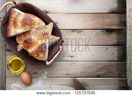 Fresh sliced pita bread on the wood table.