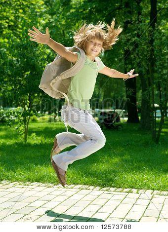 Back to School.Happy Schoolgirl Outdoor