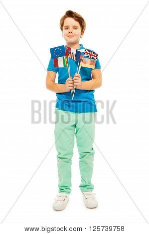 Whole-length picture of young boy with flags of different nations, isolated on white background