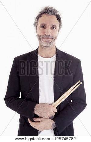 Studio Portrait Of Young Drummer On White Background