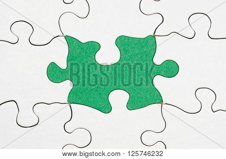 image of a puzzle with a missing piece