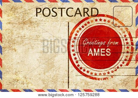 greetings from ames, stamped on a postcard