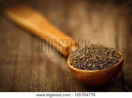 Close up of ajwain seeds in a wooden spoon