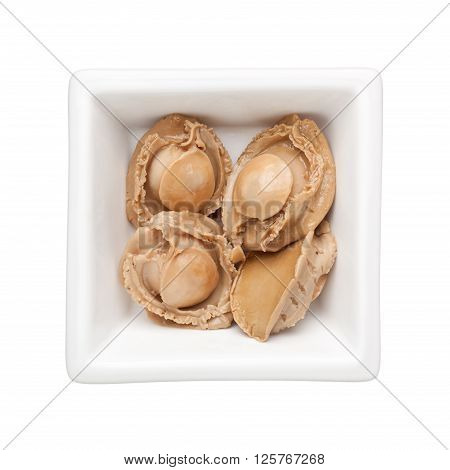 Cooked abalones in a square bowl isolated on white background