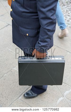 Corruption. Dirty Cop With Leather Glove And The Case After Payment