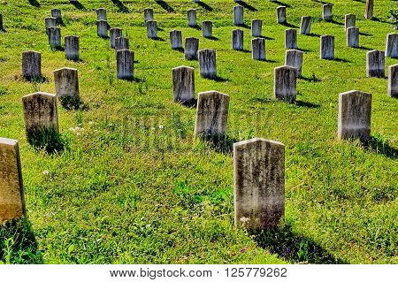 Rows of old, marble, unmarked grave  headstones