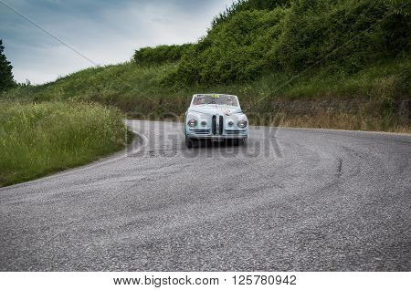 PESARO, ITALY - MAY 15: HEALEY Duncan Drone 1948 on an old racing car in rally Mille Miglia 2015 the famous italian historical race (1927-1957) on May 2015