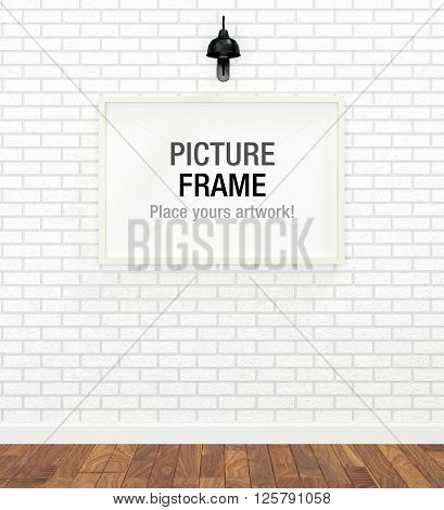 Picture of white frame over the white brick wall