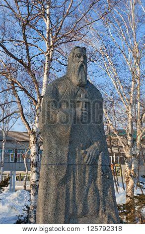 YUZHNO-SAKHALINSK RUSSIA - MARCH 17 2016: Statue of Andrew the Apostle in Yuzhno-Sakhalinsk Russia. Work of sculptor Vladimir Chebotarev diorite 2000