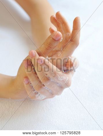 Washing Woman Hands On A Background A White Towel