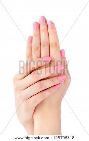 Closeup Of Hands Of A Young Woman With Pink Manicure On Nails Isolated On White Background