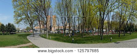 DNEPROPETROVSK, UKRAINE - APRIL 11: Townspeople are walking in New Park near Babylon shopping centre on Dnieper riverbank in front of Sunny (Solnechny) residential district on April 11, 2016 in Dnepropetrovsk, Ukraine.