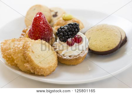 variety of decorated sweet pastry on plate