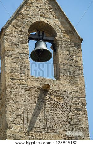 Salon-de-Provence (Bouches-du-Rhone Provence-Alpes-Cote-d'Azur France): facade of historic church: bell and sundial