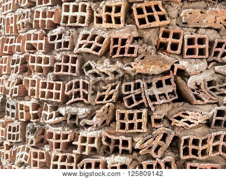 Front view of wall made of faulty bricks