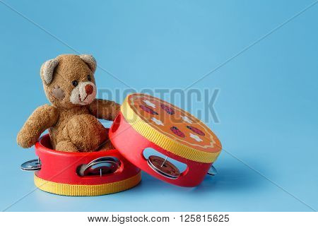 Toy Musical instruments with bear on blue